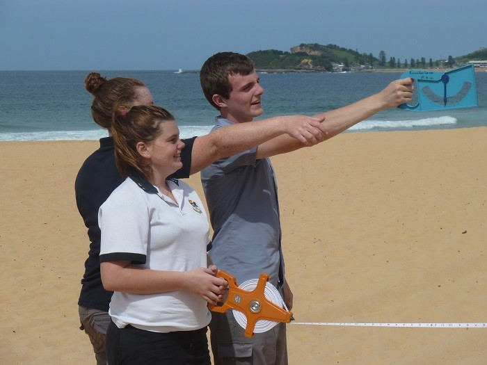 Students doing an environmental study on the beach