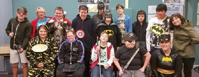Support unit students and teachers dressed as superheroes
