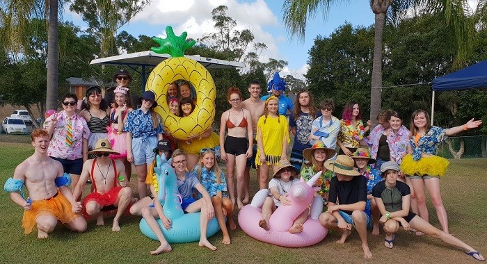 Teachers and students standing in a group at the swimming carnival