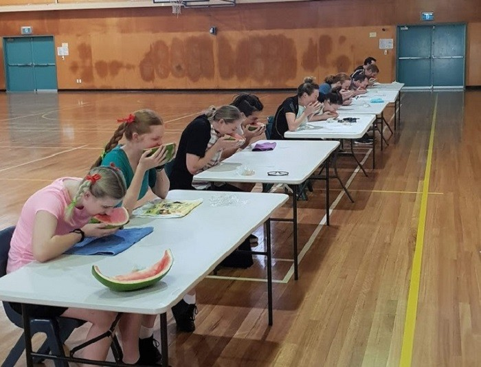 Students having a watermelon eating contest